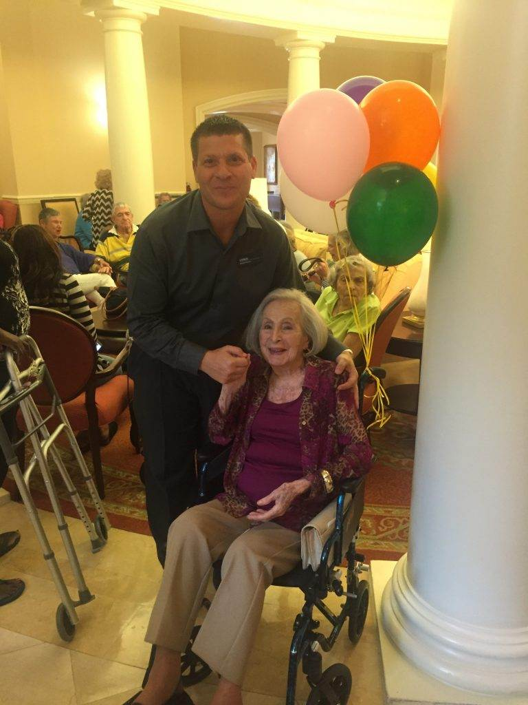 Executive Director Chris Kochan shares a moment with Bette on her 104th birthday